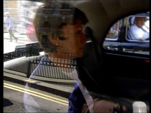 kenneth noye's wife brenda noye sitting in back of taxi - kenneth noye stock videos & royalty-free footage