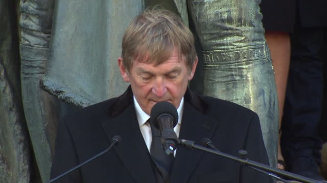 Kenny Dalglish reading the poem 'Footprints in the Sand' outside St George's Hall in Liverpool after the Hillsborough inquest ruled the victims were...