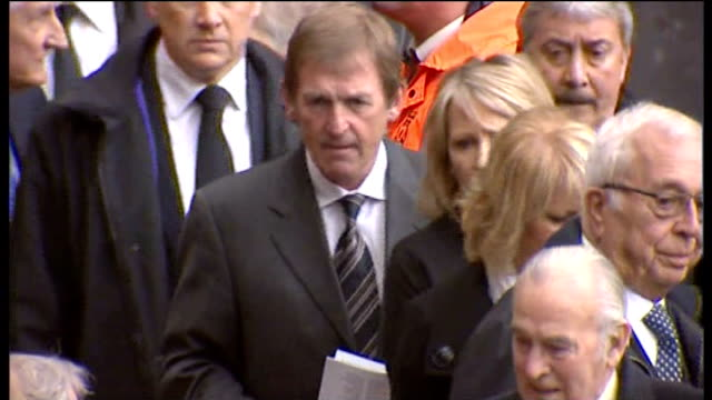Kenny Dalglish sacked by Liverpool LIB / Dalgish in stadium at Hillsborough memorial Crowds holding Liverpool scarfs in air