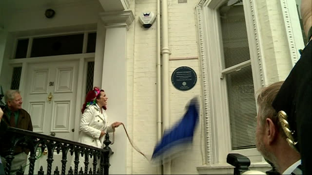 kenny everett honoured with british comedy society blue plaque england london lexham gardens ext curtain covering blue plaque honouring kenny everett... - kenny everett stock videos & royalty-free footage