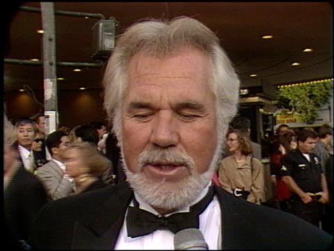 kenny rogers at the 'robin hood' premiere on june 10, 1991. - ウエストウッドヴィレッジ点の映像素材/bロール