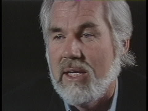 "kenny rogers says that recording the hit charity single ""we are the world"" brought out an inner energy in the artists that participated. - willie nelson stock-videos und b-roll-filmmaterial"