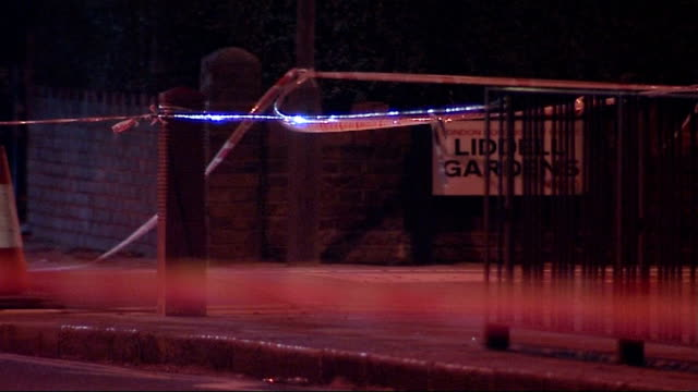 kensal rise tornado aftermath: night shots of police patrolling cordonned off streets; england: north london: kensal rise: ext/night police officers... - road closed englisches verkehrsschild stock-videos und b-roll-filmmaterial