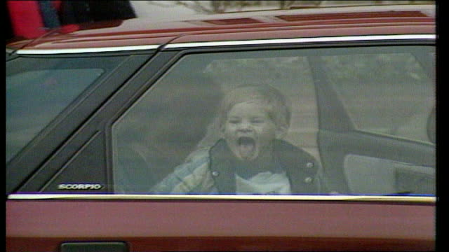 Chepstow Villas Princess Diana Prince Harry in car as he sticks tongue out at press LIB Prince Princess of Wales taking Prince Harry to nursery for...