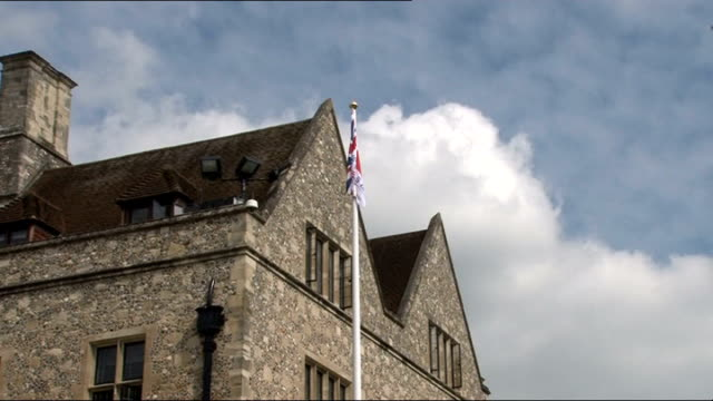 chatham dockyard: ext union jack flag raised on mast as band plays army officer saluting as national anthem played sot army band playing sot - union army stock videos & royalty-free footage