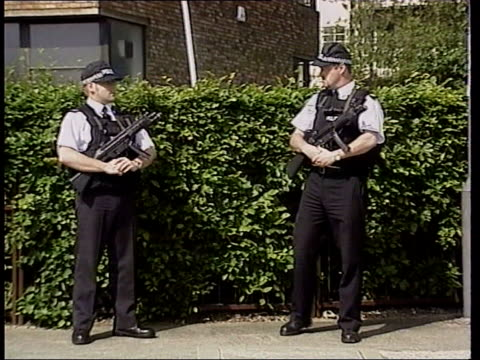 kent dartford ext armed police officers on guard outside police station where kenneth noye is being held cs gun held by police officer pull police... - kent england stock videos & royalty-free footage