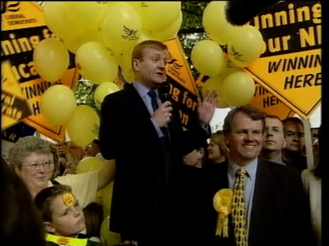 kent folkestone ext charles kennedy eating strawberry during campaign kennedy along surrounded by supporters liberal democrat conservative supporters... - charles kennedy stock videos & royalty-free footage
