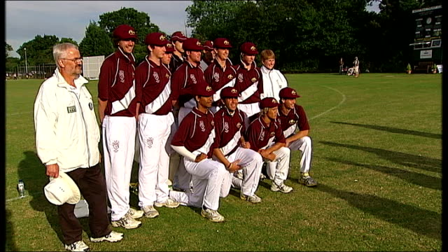 gvs of aboriginal indigenous cricket team lined up on pitch for photocall - squadra di cricket video stock e b–roll