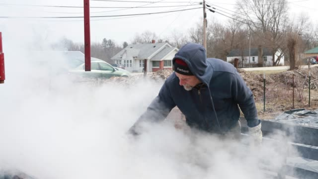 kent macpherson strains boiling maple tree sap while volunteering to help make wood fired maple syrup at the knightridge farmstand sunday march 10... - maple syrup stock videos & royalty-free footage