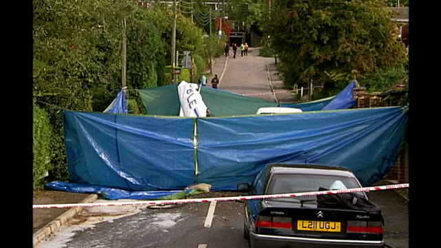 accident report released TX Remains of crashed light aircraft in suburban street surrounded by tarpaulin