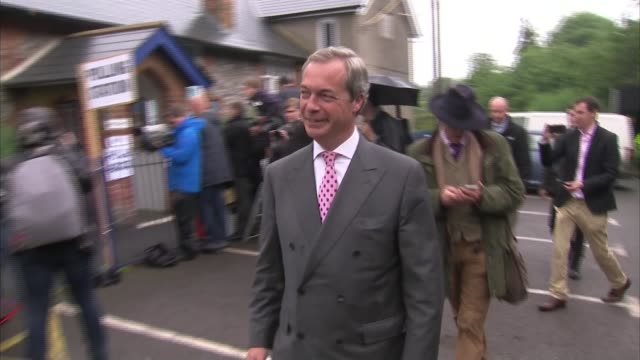kent: westerham: biggin hill: cudham church of england primary school: ext nigel farage mep arriving to vote farage posing for photocall - biggin hill stock videos & royalty-free footage