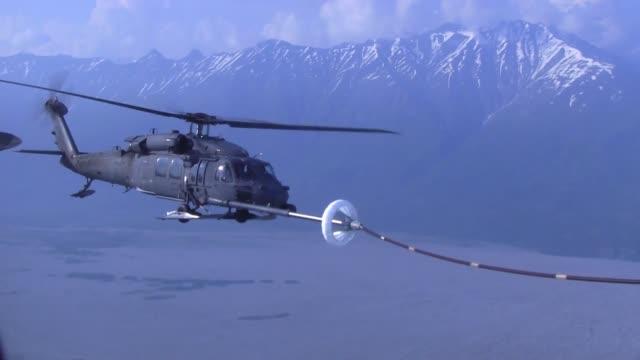 kentucky air national guard special tactics squadron perform open ocean jumpmaster training in alaska - diving flipper stock videos & royalty-free footage