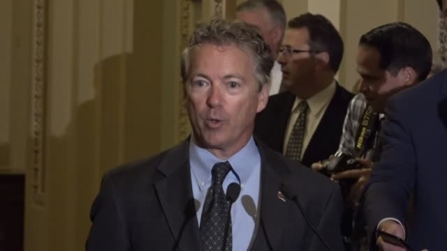 Kentucky Senator Rand Paul is coaxed to the microphone for an impromptu news briefing with reporters after Senate Republicans met to discuss how to...