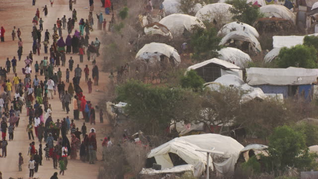 Kenya, Dabaab: People walking and tents