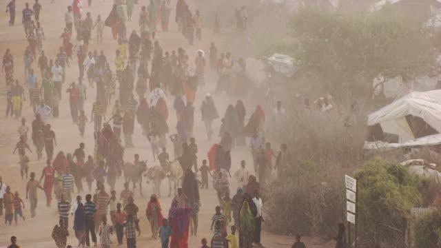 kenya dadaab : people who run in kambioos camp - refugee camp stock videos & royalty-free footage