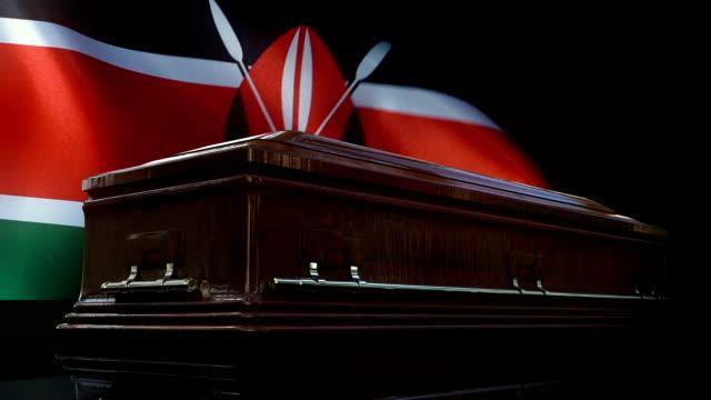 kenyan flag behind coffin - kenyan flag stock videos & royalty-free footage