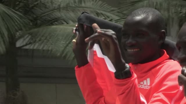 kenyan marathon runner dennis kipruto kimetto beat the world record in 2014 and is one of 3 finalists for the male athlete of the year - finalist stock videos and b-roll footage