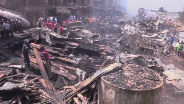kenyan officials work at the site of a fire burned down timber shops in gikomba market in nairobi kenya on june 28 2018 nairobi senator sakaja... - nairobi stock videos and b-roll footage