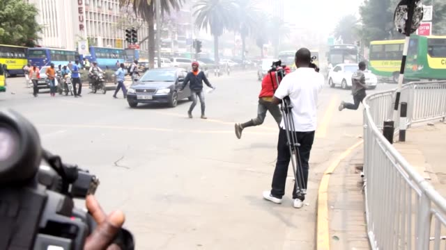 kenyan opposition supporters march towards the independent electoral and boundaries commission building to protest against election commission... - raila odinga stock videos and b-roll footage