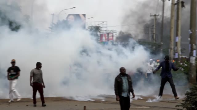 Kenyan police intervene to supporters of political opposition leader Raila Odinga who are trying to gather near the country's main airport and Uhuru...