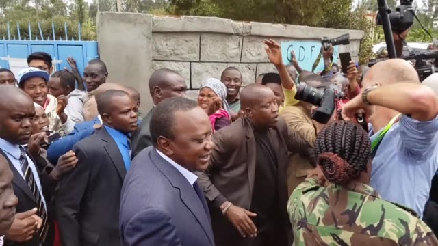 kenyan president uhuru kenyatta casts his vote in elections headlined by a knife edge battle between the incumbent and his rival raila odinga that... - raila odinga stock videos and b-roll footage