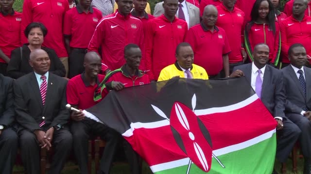kenyan president uhuru kenyatta handed the nation's flag to athletes heading the rio olympics asking them to show the world that they can compete and... - kenyan flag stock videos & royalty-free footage