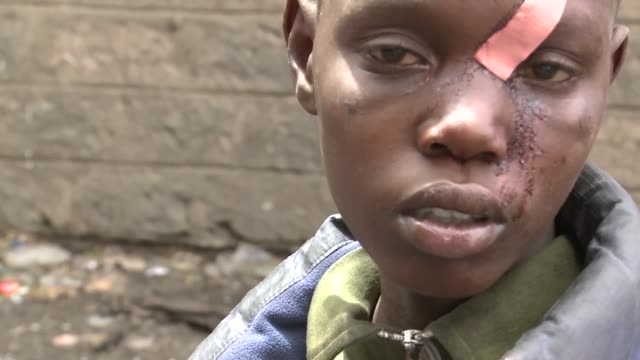 kenyan street boys in the streets of nairobi sniff glue from bottles. they do that to soften their hard street life surviving by begging and often... - glue stock videos & royalty-free footage
