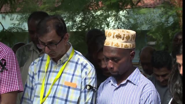 Kenyans pay tribute to the 21 people who were killed in a terrorist attack in a Nairobi hotel complex
