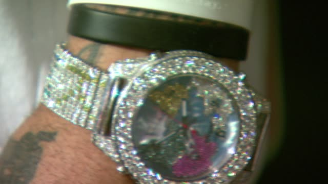 kenyon martin's bling at the nba court-ture 2007 fashion show at nba store in new york, new york on march 21, 2007. - bling bling stock-videos und b-roll-filmmaterial