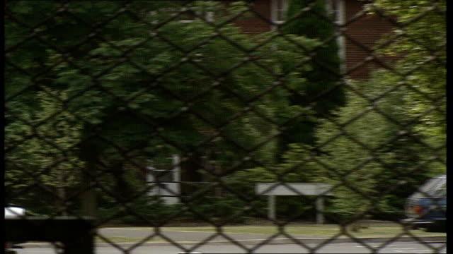 keogh barracks car park, seen thru wire fence: aldershot perimeter fence: lock on gate: country road: signs 'danger army department land', 'army... - aldershot stock videos & royalty-free footage