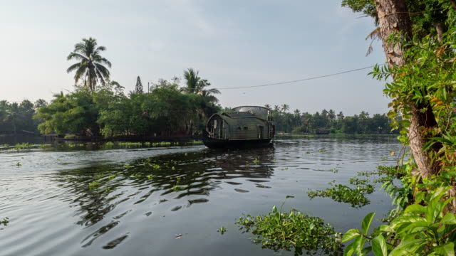 kerala backwater river with boat traffic, time lapse - backwater stock videos & royalty-free footage
