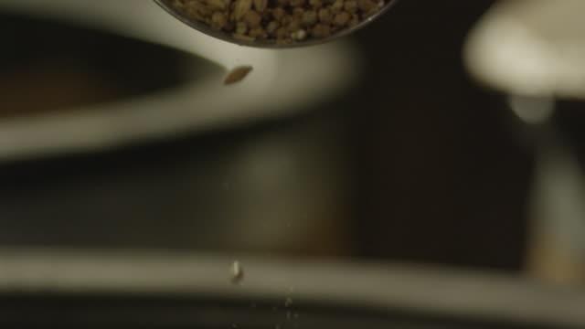 kernels of barley seeds falling in a pile - milkshake stock videos & royalty-free footage