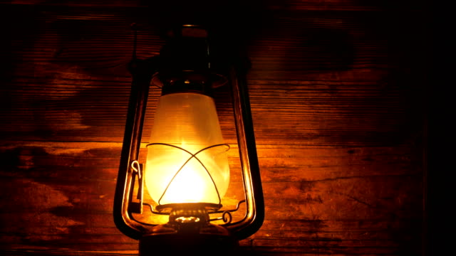 kerosene lamp with old wooden wall - lantern stock videos & royalty-free footage