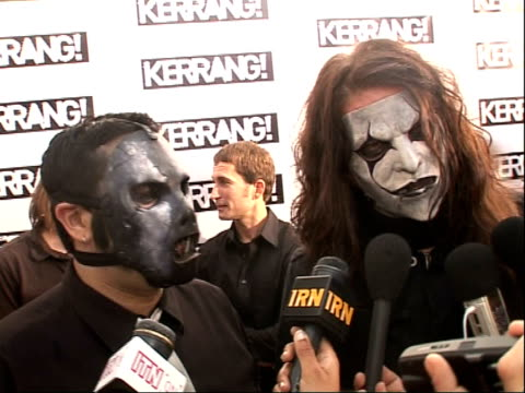 Interviews Slipknot speaking to press SOT and shaking hands with members of Metallica as they arrive On cancelling tour because of Joey's broken...