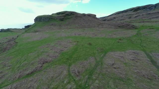 kerrera island scotland, aerial view of valley and coastline - hebriderna bildbanksvideor och videomaterial från bakom kulisserna