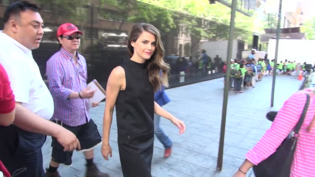 Kerri Russell exits Good Day New York and signs for a fan before getting into her car in New York NY on 8/15/13