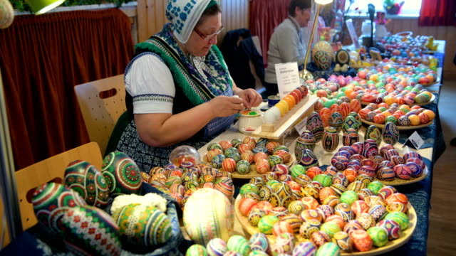 kerstin hanusch paints an easter egg during the annual sorbian easter egg market at the sorbian cultural center on march 17 2018 in schleife germany... - annual event stock videos and b-roll footage