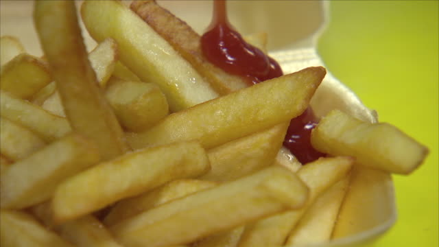 ketchup on chips - ketchup stock videos and b-roll footage
