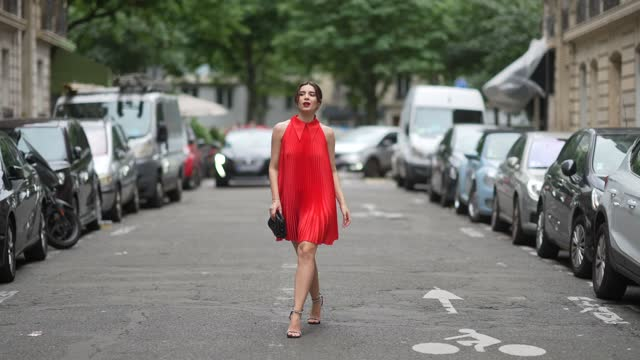ketevan giorgadze @katie.one wears a red satin mini pleated sleeveless dress with wing collar from selezza london, crystal earrings and ring from... - brown hair stock videos & royalty-free footage