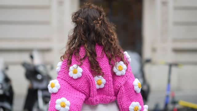 ketevan giorgadze @katie.one wears a white ribbed top from zara, a chunky knit neon hot pink / fuchsia oversized crop cardigan with handmade... - cardigan sweater stock videos & royalty-free footage