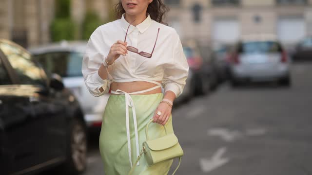 ketevan giorgadze @katie.one wears oversized square sunglasses in mauve by for art's sake, a pistachio green flowy lustrous satin midi skirt by... - celeb stock videos & royalty-free footage