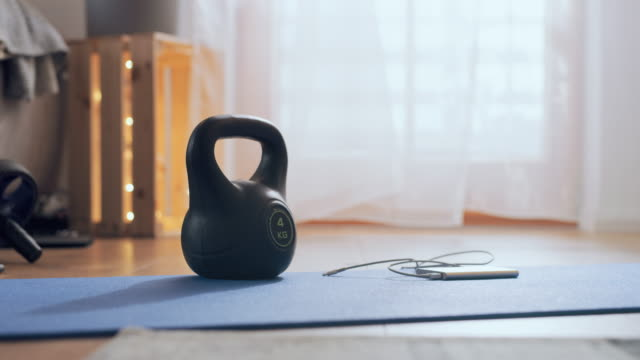 ms kettle and a power bank laying on an exercise mat - exercise room stock videos & royalty-free footage