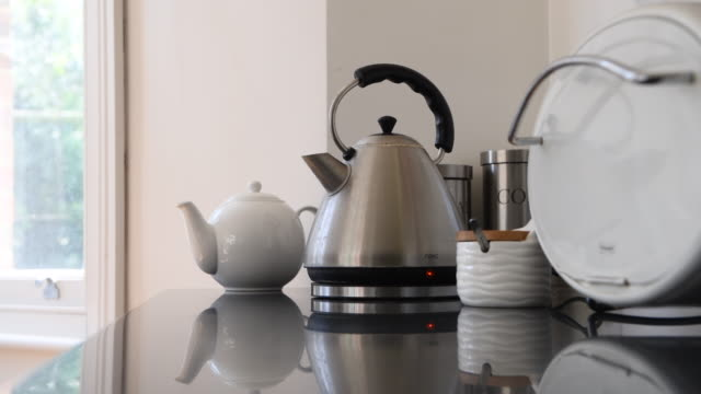 kettle boiling in the kitchen - preparation stock videos & royalty-free footage