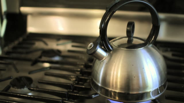 kettle boiling on gas hob - kettle stock videos & royalty-free footage