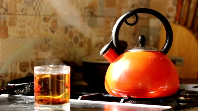kettle boils on a gas stove. - boiling stock videos & royalty-free footage