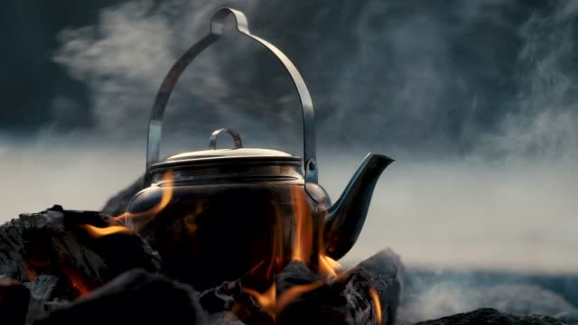 a kettle on a bonfire - camping stock videos & royalty-free footage