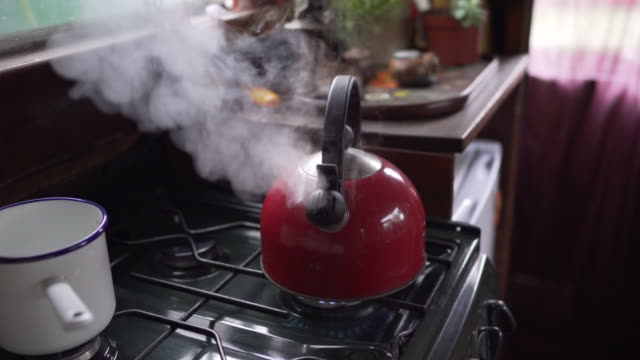 a kettle with a whistle boiling with steam on the cooker in a narrow boat (with sound) - barge stock videos & royalty-free footage