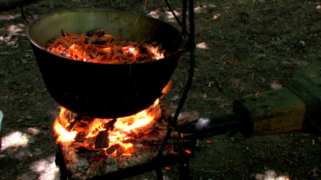 HD Kettle with cooking meat in forge