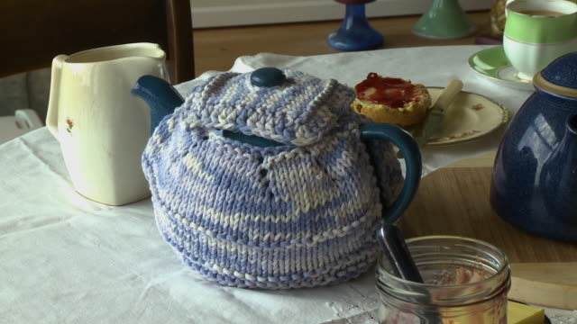 kettle wrapped in knitted sweater - boiler stock videos & royalty-free footage