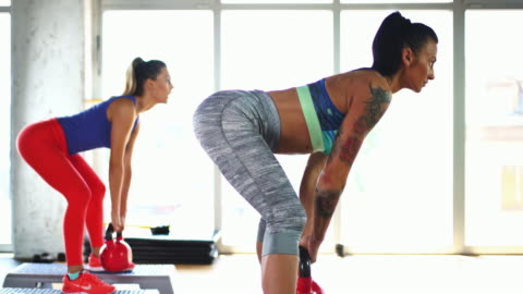 kettlebell dead lift exercise. - trousers stock videos & royalty-free footage